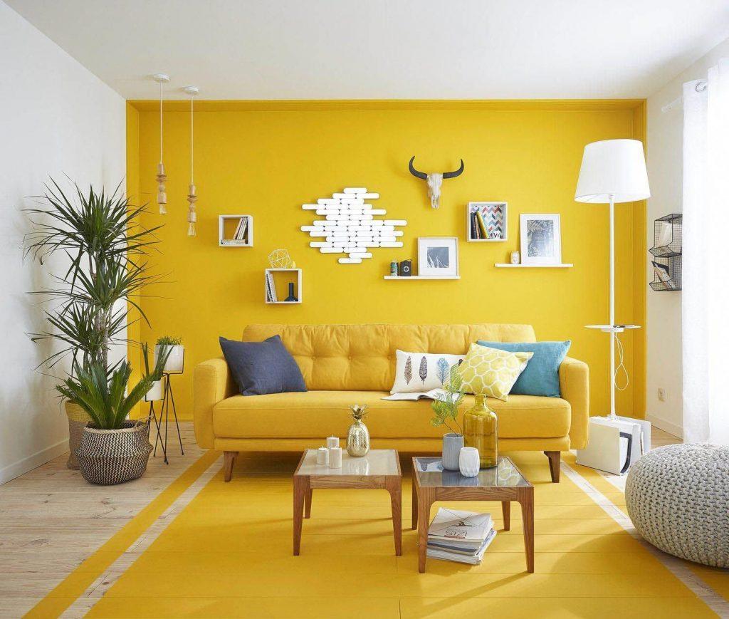 Sofa màu vàng căn cứ tiêu chí chọn màu sắc cùng với tường